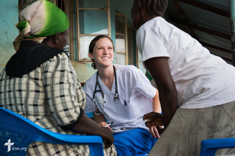 Madison McKinney of Statesville, N.C., attending Holy Trinity Lutheran Church, greets patients at the Mercy Medical Team clinic Wednesday, June 11, 2014, at the Luanda Doho Primary School in Kakmega County, Kenya. LCMS Communications/Erik M. Lunsford
