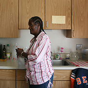 Annie Ricks and her family were the last residents to move out from the Cabrini Green low income high rise building. They moved to Wentworth Gardens, a public housing project that Ricks claims is not safe for her family.<br /> Photography by Jose More