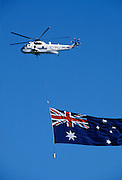 Australian flag being flown over Sydney Harbour for Australia's Bicentenary, 1988
