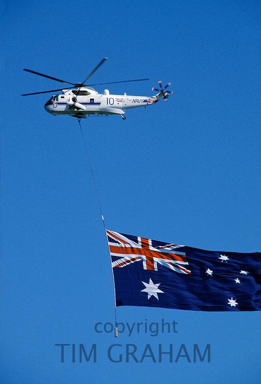 Australian flag being flown over Sydney Harbour for Australia's Bicentenary, 1988