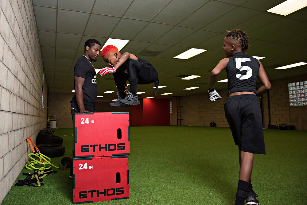 "Maxwell ""Bunchie"" Young, 10, clears 48"" on a box jump with room to spare while he and Havon Finney Jr. , 9, train with coach Mike Evans at Laced Facts. Bunchie and Havon have been playing football together since they were toddlers, and both have received interest from D-1 schools already."