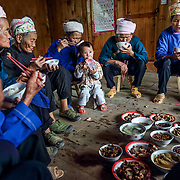 A family invites friends to celebrate Xia's acceptance to university -- a rare achievement in a mountain village. <br /> <br /> Shielded from the rest of Chinese civilization by a cascade of steep mountains, this village and the other surrounding lush villages have kept their Dong minority traditions and arts from centuries ago.<br /><br />With a history that goes back to the Tang dynasty, the area is adorned with stunning wooden Flower Bridges, bell towers and cascades of beautiful old houses. The Dong people have no written language, but use fine embroidery to communicate their love.<br /><br />Yet, as highways and tunnels plough through these mountains, the future of the village&rsquo;s 525 households is at crossroads. There is already a government blueprint to turn Dimen into a satellite town in the coming three years, as China embarks on its latest urbanization drive.