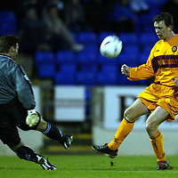 St Johnstone v Motherwell....10.01.04 Scottish Cup 3rd Round<br />Derek Adams shot is blocked by Craig Nelson<br /><br />Picture by Graeme Hart.<br />Copyright Perthshire Picture Agency<br />Tel: 01738 623350  Mobile: 07990 594431
