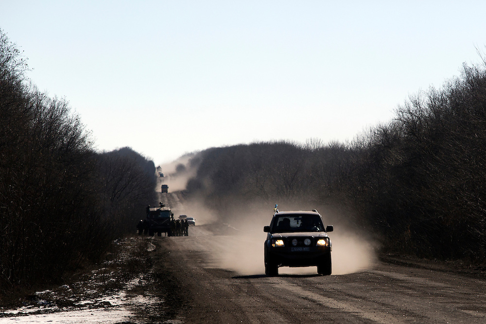 Vehicles drive away from Debaltseve, Ukraine on February 18, 2015 on a road about 30 kilometers from the city. Wednesday saw a steady stream of vehicles leaving the embattled city, which had apparently fallen to separatist forces.