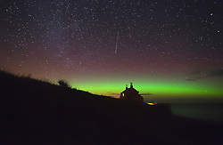 FILE PICTURE © Licensed to London News Pictures. 22/01/2012. London, UK. Aurora seen above The Bathing House a Grade II listed building near Embleton Bay in Northumberland, UK, on the evening of 22 January 2012. The Aurora Borealis, known as The Northern Lights, which normally appear above Iceland and Norway, were seen further south this weekend due to unusual solar activity. Photo credit : Mike Ridley/LNP