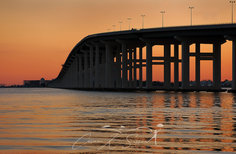The Biloxi Bay Bridge, viewed from Front Beach in Ocean Springs, Mississippi, is silhouetted by the setting sun on Dec. 18, 2010. The bridge, part of U.S. Highway 90, connects the cities of Ocean Springs and Biloxi. The original bridge was damaged by Hurricane Katrina in August 2005. The new bridge spans six lanes and includes a pedestrian walkway. (Photo by Carmen K. Sisson/Cloudybright)