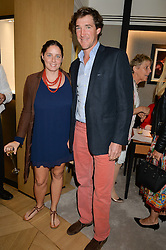 LUKE TOMLINSON and his wife CATA at the draw for the Jaeger-LeCoultre Gold Cup held at Jaeger-LeCoultre, 13 Old Bond Street, London on 8th June 2015.