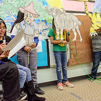 """Jaden Banteah, left, and Jordan Romancito narrate as """"man"""" Shayla Quam, """"water buffalo"""" Alexie Shack and """"tiger"""" Raynan Quam act out """"How the Tiger Got His Stripes""""during A:shiwi story night at Dowa Yalanne Elementary in Zuni Thursday."""