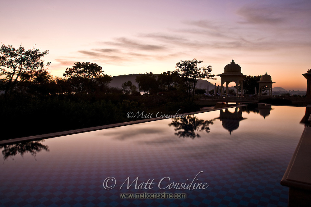 View of the pool at sunrise from a poolside room in the fabulous Oberoi Udaiavilas in Udaipur India.<br /> (Photo by Matt Considine - Images of Asia Collection)