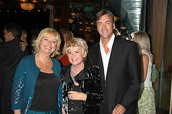 Left to right, TV presenter JUDY FINNEGAN, GLORIA HUNNIFORD and RICHARD MADLEY at a party to celebrate the publication of 'Next To You' - Caron's Courage remembered by her mother Gloria Hunniford held on Caron's birthday at The Hilton Park Lane, London on 5th Octobe 2005.<br /><br />NON EXCLUSIVE - WORLD RIGHTS