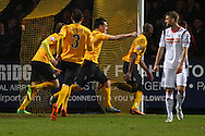 Tom Elliott of Cambridge United (4th left) celebrates scoring the opening goal during the Skrill Conference Premier match at the Abbey Stadium, Cambridge<br /> Picture by David Horn/Focus Images Ltd +44 7545 970036<br /> 11/03/2014