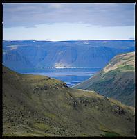 Bíldudalur seen from across the fiord Trostansfjörður, Hvanntóbrekkur, Suðurfjarðahreppur. Bíldudalur, Arnarfjörður, séð ofan af Hvanntóbrekkum fyrir ofan Trostansfjörð, Suðurfjarðarhreppur.&#xD;<br />