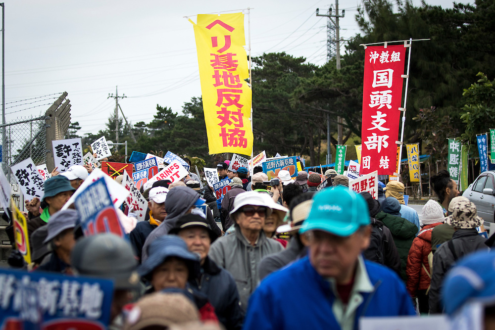 OKINAWA, JAPAN - FEBRUARY 1 : Anti U.S. Base protesters with placards stage a rally outside of the U.S Marine Camp Schwab to protest against the construction of the new U.S Marine Airbase in Nago, Okinawa, Japan on Wednesday, February 1, 2017. Okinawa Gov. Takeshi Onaga arrived in the United States on Tuesday, aiming to convey to President Donald Trump's administration local opposition to a plan to relocate a U.S. airbase within the southern island prefecture. (Photo by Richard Atrero de Guzman/NURPhoto)