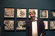 Federico Giudiceandrea, industrialist and collector, poses in front of some LP covers illustrated with drawings inspired to works by Maurits Cornelis Escher, at Palazzo Reale in Milan June 23, 2016. Giudiceandrea is one of the curator of Escher exhibition that takes place at Palazzo Reale from June 24 to Jannuary 27, 2017; he is also the main Escher collector in Europe. &copy; Carlo Cerchioli<br />