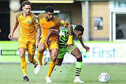 Newport County's Joss Labadie(4) and Forest Green Rovers Ebou Adams(14) challenge for the ball during the EFL Sky Bet League 2 match between Forest Green Rovers and Newport County at the New Lawn, Forest Green, United Kingdom on 31 August 2019.