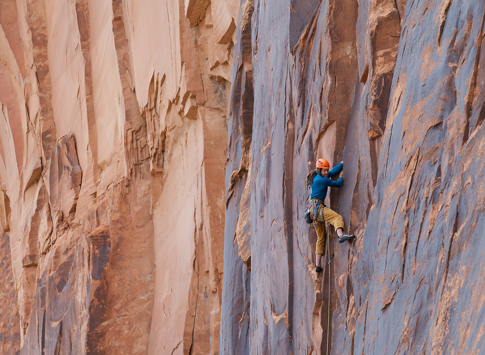 Dustin leading Pinhead, 5.10b at Wallstreet in Moab, UT