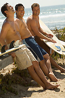Three Surfers at Beach