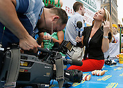 NEW YORK, NY-06 JUL04-- Media from all over the world assembled to cover the Hot Dog Eating Competition, contributing somewhat to the circus-like atmosphere. (Extra) The Gazette/Liam Maloney