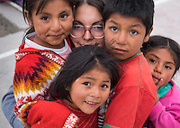 AREQUIPA, PERU - APRIL 8, 2014: Volunteer and kids in the community of Flora Tristan for HOOP Peru. HOOP Peru is a NGO fully committed to breaking the cycle of poverty by empowering the Flora Tristan families through enhancing their education.