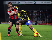 Kyle Vassell and Peter Murphy battle during the Sky Bet League 2 match between Morecambe and Dagenham and Redbridge at the Globe Arena, Morecambe, England on 1 December 2015. Photo by Pete Burns.