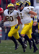 MORNING JOURNAL/DAVID RICHARD&amp;#xA;Mike Hart, left, put the Wolverines on the board first after a handoff by Chad Henne.<br />