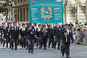 south afican miltary veterans march during Brisbane ANZAC day 2014 parade <br />
