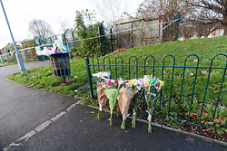 © Licensed to London News Pictures. 04/02/2018. London, UK. Flowers at the crime scene in Tottenham this morning. A murder investigation has been launched following the fatal stabbing of a 22 year old man yesterday. Police were called on Saturday, 3 February to St Mary's Close, N17 following reports of a stabbing. Photo credit: Vickie Flores/LNP