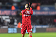 Rudy Gestede (14) of Middlesbrough applauds the travelling fans at full time during the EFL Sky Bet Championship match between Swansea City and Middlesbrough at the Liberty Stadium, Swansea, Wales on 14 December 2019.