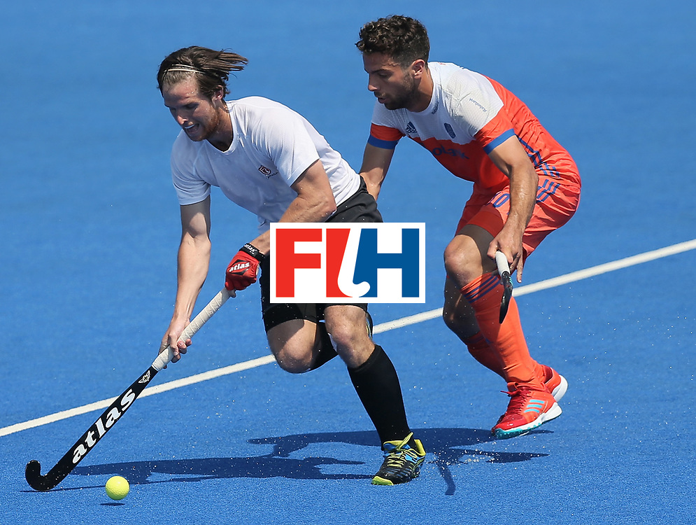 LONDON, ENGLAND - JUNE 19: Adam Froese of Canada is put under pressure by Valentin Verga of the Netherlands during the Hero Hockey World League Semi-Final match between Netherlands and Canada at Lee Valley Hockey and Tennis Centre on June 19, 2017 in London, England. (Photo by Alex Morton/Getty Images)