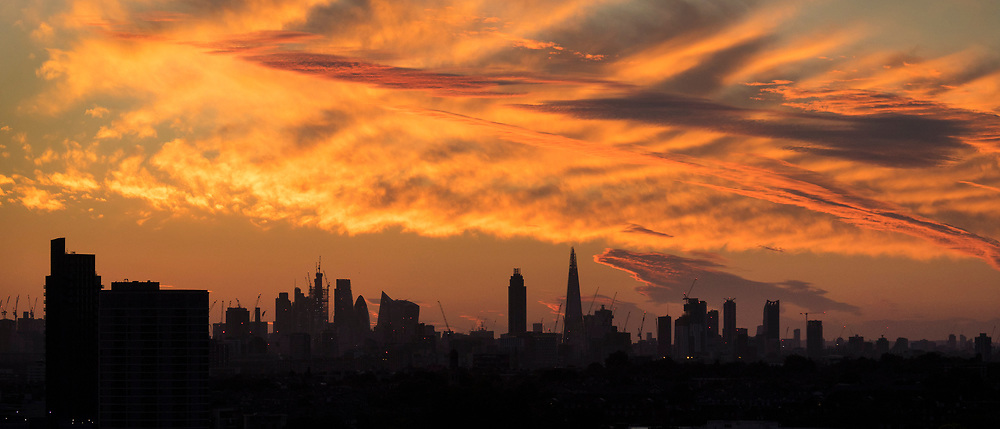 © Licensed to London News Pictures. 21/06/2018. London, UK. Spectacular clouds form over London just before dawn ahead of the summer solstice sunrise at the start of the longest day of the year. A period of hot and sunny weather is forecast for much of the UK over the next 10 days. Photo credit: Peter Macdiarmid/LNP