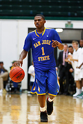 Nov 16, 2011; San Francisco CA, USA;  San Jose State Spartans guard Keith Shamburger (1) dribbles the ball up court against the San Francisco Dons during overtime at War Memorial Gym.  San Francisco defeated San Jose State 83-81 in overtime. Mandatory Credit: Jason O. Watson-US PRESSWIRE
