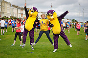 06/08/2012 No fee for Repro: Aphria O'Higginns from Loughlinstown is pictured with Splash's the new mascot of the DLR LEisure Services Loughlinstown helping raise money for the medical centre pictured warning up for the DLR Bay 10K road race. Pic Jason Clarke Photography