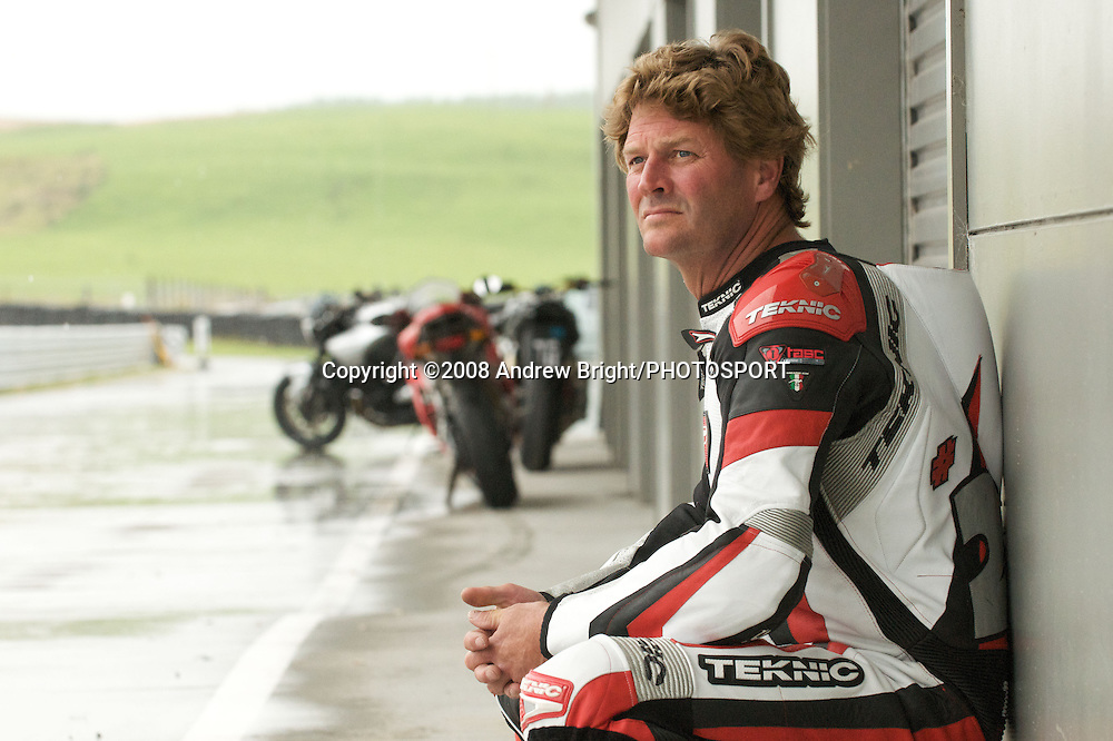 2 time World Superbike Champion and Taupo resident Fred Merkel watches the rain close in ahead of the B.A.D.D. 3 hour endurance motorcycle race at Taupo Motorsport Park. Monday 29th December 2008. Photo: Andrew Bright/PHOTOSPORT