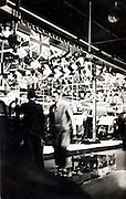 assembly line at a English car factory 1930s