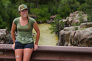 Sierra Jeffers stops at Baker's Bridge north of Durango, Colorado, to observe the discoloration of the Animas River. Jeffers works at a local rafting company as a river guide, one of the many tourism industries directly affected by this environmental disaster.