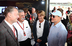 Actor and Director Woody Harrelson (right) speaks with Chief Executive Officer of the Formula One Group Chase Carey (second left) during the 2017 British Grand Prix at Silverstone Circuit, Towcester.