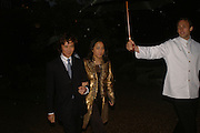 ANDY AND PATTI WONG, Cartier dinner in the Chelsea Physic Garden. 22 May 2006. ONE TIME USE ONLY - DO NOT ARCHIVE  © Copyright Photograph by Dafydd Jones 66 Stockwell Park Rd. London SW9 0DA Tel 020 7733 0108 www.dafjones.com
