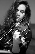 Kimi Samson plays violin Monday in Florence during practice for Dylan LeBlanc's Friday show at 116 E Mobile. Samson, who has lived here since 2002, plays violin in studio and for a variety of bands in the Shoals.