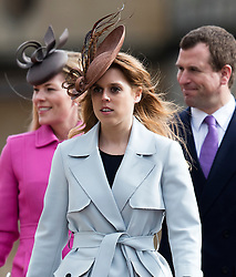 WINDSOR - UK - 27th Mar 2016: HM Queen Elizabeth, accompanied by HRH The Duke , The Duke and members of the royal family attends the annual Easter Sunday service at St George's Chapel in the grounds of Windsor Castle.<br /> <br />  Autumn Phillips, Peter Phillips, Princess Beatrice.<br /> Photograph by Ian Jones.