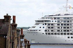 © Licensed to London News Pictures. 03/07/2016. Luxury apartments of The World pass a modeest Victorian terrace at Gravesend. The World residential cruise ship has arrived in Greenwich, London. MS The World is a residence at sea, carrying wealthy passengers around the world who own apartments on board. The ship, which was launched in 2002, has 165 apartments.  As well as six restaurants, the World has a large lobby, gourmet deli and grocery store, a boutique and showroom, fitness center, billiard room, golf simulator and putting greens, a full-sized tennis court, jogging track, a spa, swimming pool, and cocktail lounge. The World last visited London in 2013. Credit: Rob Powell/LNP