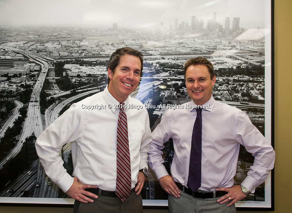 Ian Anderson, left, and Paul Kerwin of Westlake Financial.<br /> (Photo by Ringo Chiu/PHOTOFORMULA.com)