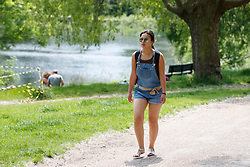 © Licensed to London News Pictures. 25/05/2017. London, UK. People enjoy hot weather in Hampstead Heath, north London as temperatures hit 29C on Thursday 25 May 2017. Photo credit: Tolga Akmen/LNP