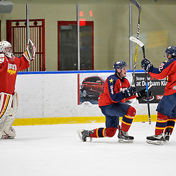 WHITBY, ON  - MAR 14,  2017: Ontario Junior Hockey League, playoff game between the Whitby Fury and Wellington Dukes. Connor Ryckman #1, Brody Morris #4 and Mitchell Martan #22 of the Wellington Dukes celebrate their game 7 victory.<br /> (Photo by Shawn Muir / OJHL Images)