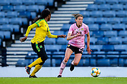 Lizzie Arnot (#23) of Scotland takes on Den-Den Blackwood (#14) of Jamaica during the International Friendly match between Scotland Women and Jamaica Women at Hampden Park, Glasgow, United Kingdom on 28 May 2019.