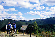 Bicyclists on the Hiawatha Rails to Trails Route. Bitterroot Mountains, North Idaho