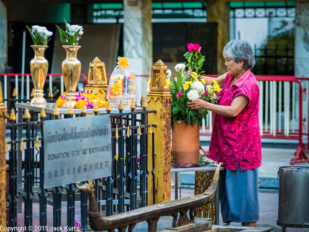 19 AUGUST 2015 - BANGKOK, THAILAND:  A woman gets Erawan Shrine ready to open. Erawan Shrine in Bangkok reopened Wednesday morning after more than 20 people were killed and more than 100 injured in a bombing at the shrine Monday, August 17, 2015. The shrine is a popular tourist attraction in the center of Bangkok's high end shopping district and is an important religious site for Thais. No one has claimed responsibility for the bombing.       PHOTO BY JACK KURTZ