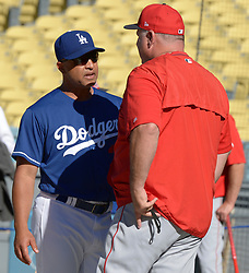 June 27, 2017 - Los Angeles, California, U.S. - Los Angeles Angels manager Mike Scioscia, right, talks with Los Angeles Dodgers manager Dave Roberts prior to a Major League baseball game between the Los Angeles Angels and the Los Angeles Dodgers at Dodger Stadium on Tuesday, June 27, 2017 in Los Angeles. (Photo by Keith Birmingham, Pasadena Star-News/SCNG) (Credit Image: © San Gabriel Valley Tribune via ZUMA Wire)