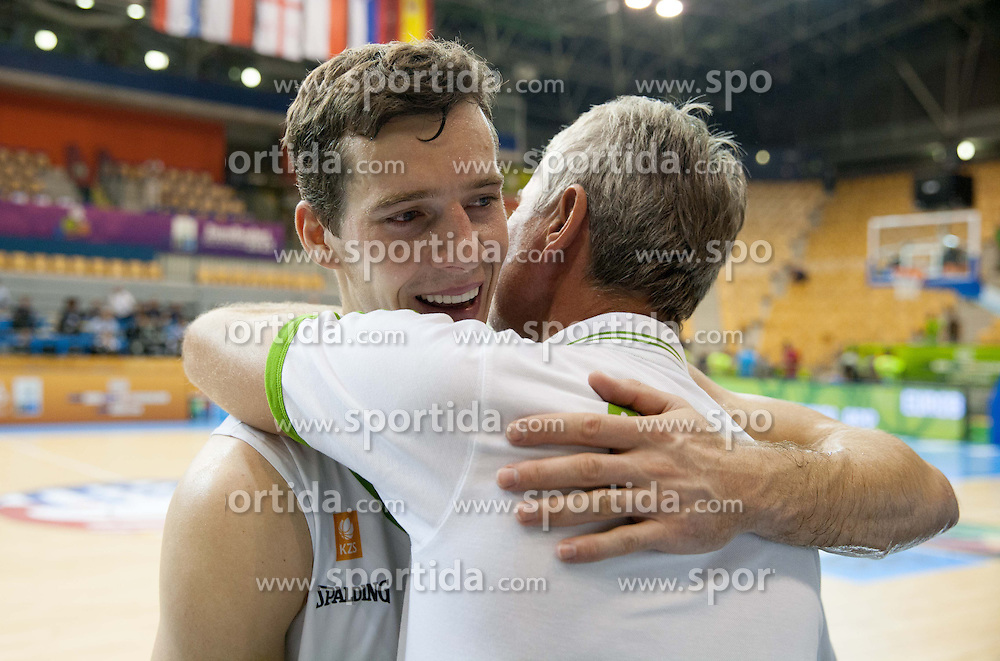 Goran Dragic of Slovenia and his father Marinko Dragic celebrate after Slovenia won during basketball match between National teams of Slovenia and Spain in Round 1 at Day 2 of Eurobasket 2013 on September 5, 2013 in Arena Zlatorog, Celje, Slovenia. (Photo by Vid Ponikvar / Sportida.com)