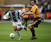 Photo: Rich Eaton.<br /> <br /> Wolverhampton Wanderers v Sheffield Wednesday. Coca Cola Championship. 28/10/2006. Deon Burton left of Wednesday tries to squeeze past Gary Breen of Wolves