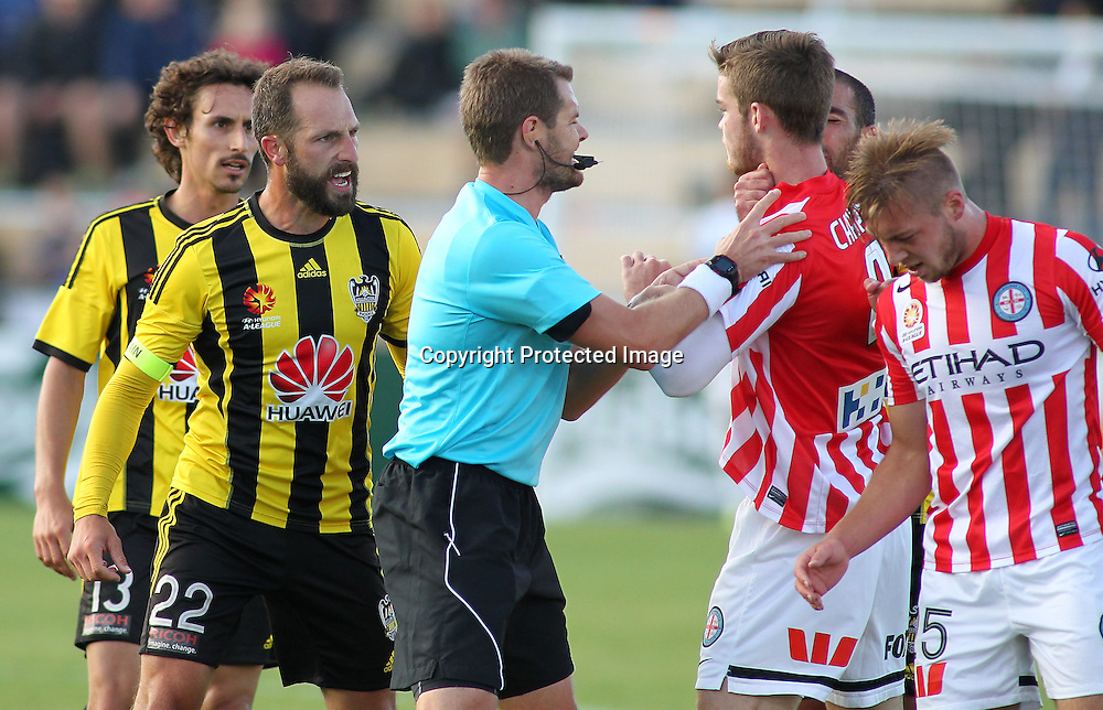 Referee Chris Beath gets between Andrew Durante & members of the Melbourne city team during the A-League football match between the Wellington Phoenix & Melbourne City, at the Hutt Recreational Ground, Wellington, 14 February 2015. Photo.: Grant Down / www.photosport.co.nz